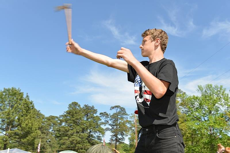 Tyler Standridge throwing a tomahawk